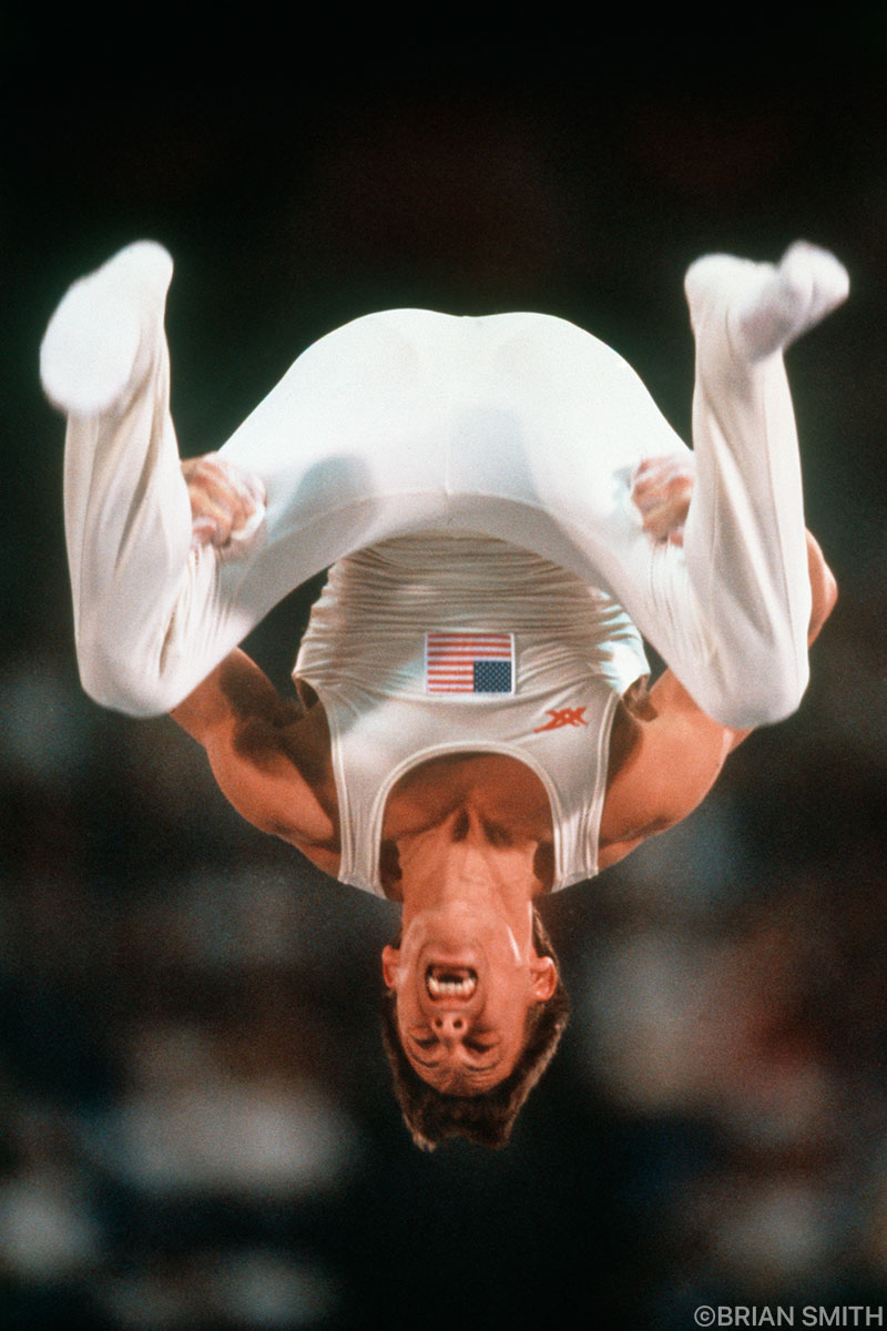 United States Olympic Gymnast Tim Daggett flips during the dismount from the Rings competition at the 1984 Los Angeles Olympics photographed by Brian Smith